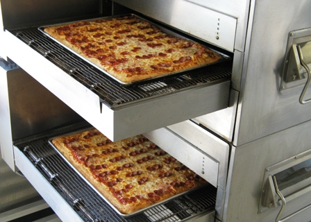 sheet pizzas in oven